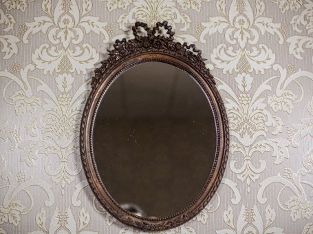 Oval Mirror in a Stylized Frame
